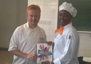 Dean of the College of Food, Neil Rippington (left) is seen presenting the student winner of the 'Cook-Off' on the Skills for Chefs course run at Barbados Community College.