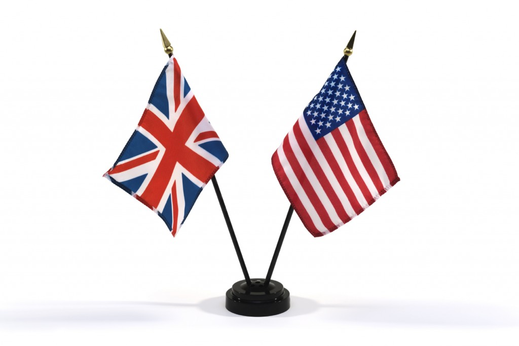 Small flags of Great Britian and the United States in a stand on a white background. See more flags from this series in my portfolio.