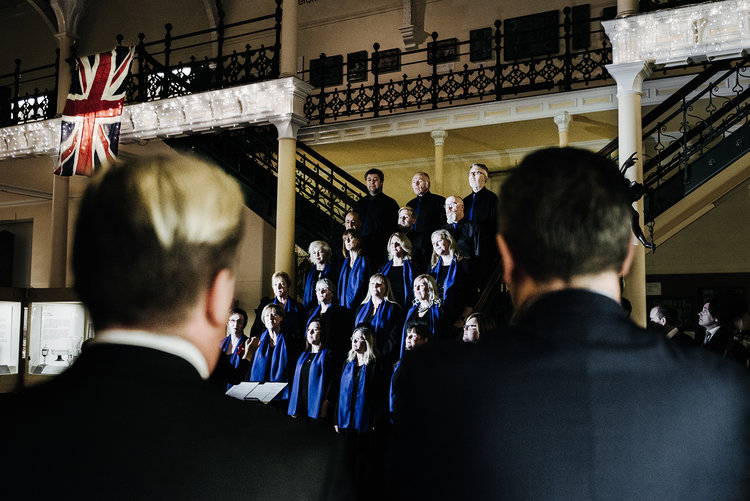 Birmingham City Choir performs Christmas songs in the Industrial room of the Birmingham Museum and Art Gallery. Image by Ed Lawes.